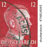 Small photo of GERMANY - CIRCA 1942: A stamp printed in Germany shows portrait of Adolf Hitler, circa 1942.