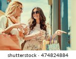 happy woman with shopping bags... | Shutterstock . vector #474824884