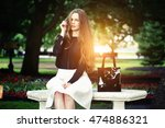 woman seating on the bench... | Shutterstock . vector #474886321