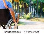 man on wheelchair in a park | Shutterstock . vector #474918925