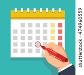 calendar on the wall and hand... | Shutterstock .eps vector #474960559