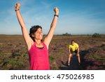 smiling runner woman rising her ... | Shutterstock . vector #475026985