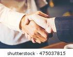 business men shaking hands ... | Shutterstock . vector #475037815