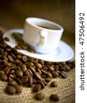 macro shot coffee beans and coffee cup - stock photo