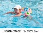 little girl swims in a swimming ... | Shutterstock . vector #475091467