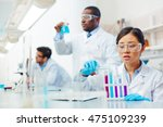 focused female asian laboratory ... | Shutterstock . vector #475109239