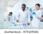 focused female asian scientist... | Shutterstock . vector #475109281