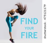 "Small photo of Beautiful young fit modern dancer lady in blue sportswear warming up, working out, dancing with her long hair flying, full length, studio image on gray background. Motivational phrase ""Find your fire"""