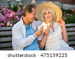 couple is holding ice cream.... | Shutterstock . vector #475159225