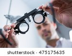 close up of optometrist holding ...   Shutterstock . vector #475175635