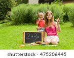mother teaches daughter count.... | Shutterstock . vector #475206445