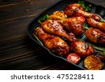 roasted chicken legs with herbs | Shutterstock . vector #475228411