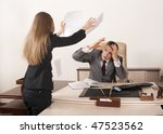Angry businesswoman throwing papers in her boss - stock photo