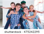 group of teenagers have a good... | Shutterstock . vector #475242295
