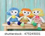 Three Happy Rag Dolls On Woode...