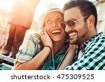 happy couple with headphones... | Shutterstock . vector #475309525