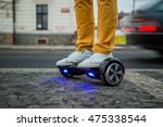 man is using hoverboard against ... | Shutterstock . vector #475338544