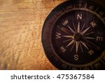 compass on wooden table in... | Shutterstock . vector #475367584