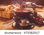 chocolate fondue with oven on... | Shutterstock . vector #475382017