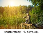 man fishes in the lakes of the... | Shutterstock . vector #475396381