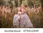 the mother and daughter in... | Shutterstock . vector #475412449