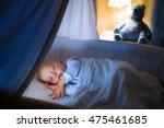 adorable baby sleeping in blue... | Shutterstock . vector #475461685