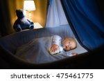 adorable baby drinking milk in... | Shutterstock . vector #475461775