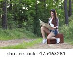 pretty girl hitchhiking on the... | Shutterstock . vector #475463281