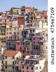 Small photo of vertical view of a coastal village in Italy , accumulation of colorful houses