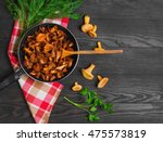 chanterelle mushrooms fried in...   Shutterstock . vector #475573819