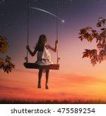 happy child girl on swing in... | Shutterstock . vector #475589254