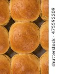 Small photo of Tasty barmy rolls with stuffing over the oven tray background
