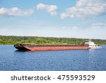 River Tugboat Moves Cargo Barg...