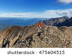hiking man in the mountains | Shutterstock . vector #475604515