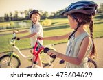 happy kids are riding bikes... | Shutterstock . vector #475604629