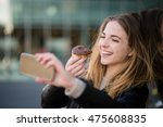 young woman taking selfie with... | Shutterstock . vector #475608835