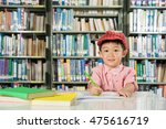 asian boy writing in library... | Shutterstock . vector #475616719