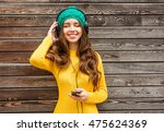 cool girl having fun listens... | Shutterstock . vector #475624369