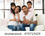 happy indian family at living... | Shutterstock . vector #475715329