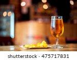 a fresh glass of cold light... | Shutterstock . vector #475717831