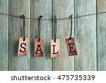 sale labels on color wooden... | Shutterstock . vector #475735339