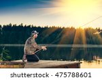 man fishes in the lakes of the... | Shutterstock . vector #475788601