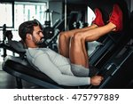 man focused on training legs on ... | Shutterstock . vector #475797889