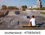 Surfer Sits On A Longboard In ...