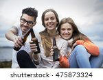 three friends toasting with...   Shutterstock . vector #475873324
