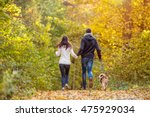 beautiful young couple with dog ... | Shutterstock . vector #475929034