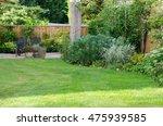 garden with patio area  lawn... | Shutterstock . vector #475939585