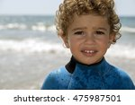 portrait of young boy by a sand ... | Shutterstock . vector #475987501