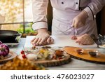 hand touches raw meat. chef...   Shutterstock . vector #476023027