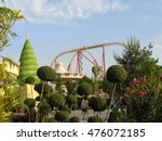 Originally trimmed trees, flowering oleander, people walking in the amusement park, Sochi, Russia, June 1, 2016 - stock photo